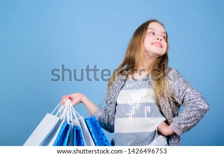 clearance sale. Sales and discounts. Small girl with shopping bags. special offer. Holiday purchase saving. Happy child. Little girl with gifts. Kid fashion. shop assistant. clearance sale concept.