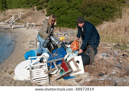 Clearing up rubbish washed up onto a small beach