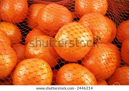Clementines in a netted bag and box
