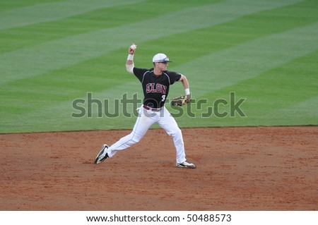 CLEMSON, SC - MARCH 24: Elon baseball player throws a Clemson batter out during college baseball action on March, 24, 2010 in Clemson, SC