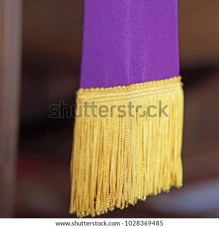 Clergy stole vestment purple and gold - Shutterstock ID 1028369485