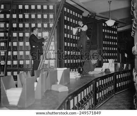 Clerks working in Capitol Document Room where all bills were kept on file, Nov. 9, 1937.