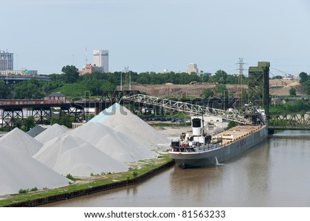CLEVELAND - JULY 24: The bulk freighter Manistee off-loads aggregate material onto the bank of the Cuyahoga River on July 24, 2011 at Cleveland, Ohio