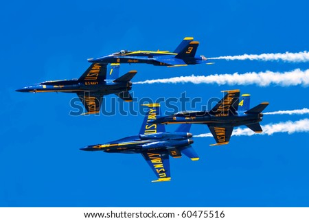 CLEVELAND, OHIO - SEPT 5: The Blue Angels break formation at the Cleveland National Airshow SEPTEMBER 5, 2010 at the Burke International Airport in Cleveland, Ohio.