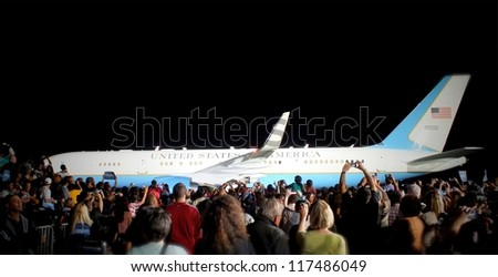 CLEVELAND, OHIO, USA - OCTOBER 25, 2012: Onlookers at a President Obama campaign stop at Burke Lake Front Airport with Air Force One in the background on October 25,2012 in Cleveland, Ohio, USA.
