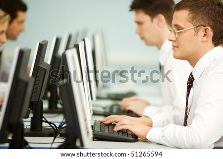 Clever businessmen typing in line at workplace