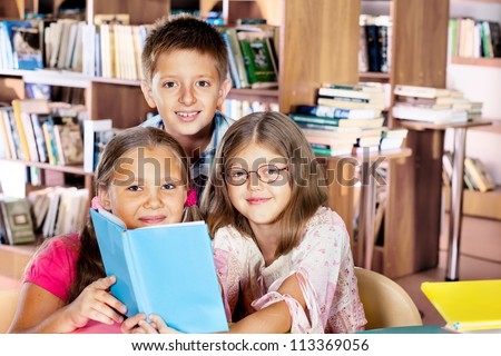 Clever kids reading in a library - stock photo