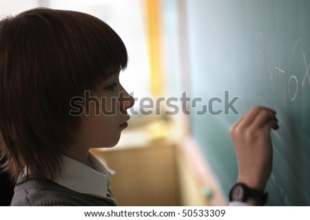 clever schoolboy writes the decision of task at board