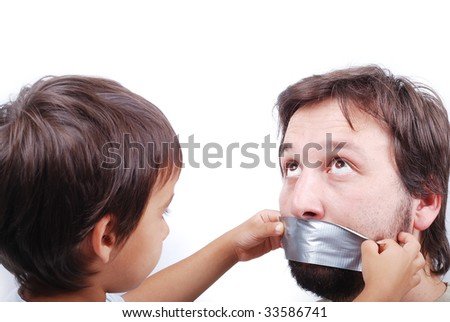 Clever son is putting a strip on father's mouth