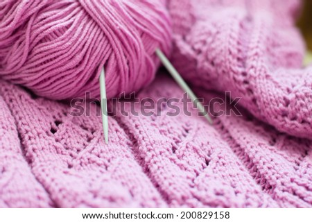 clew and pink woven texture fabric hand made knitting sweater, cardigan or shawl detail design copy space background close up image