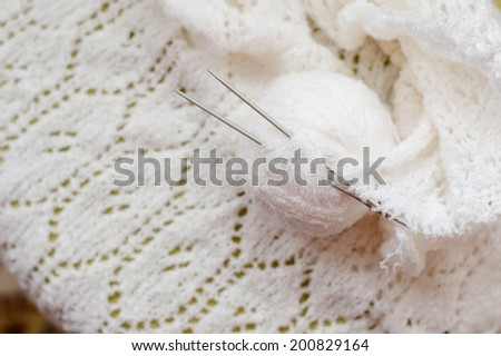 clew and white woven hand made knitting sweater, cardigan or shawl detail design texture fabric copy space background close up image