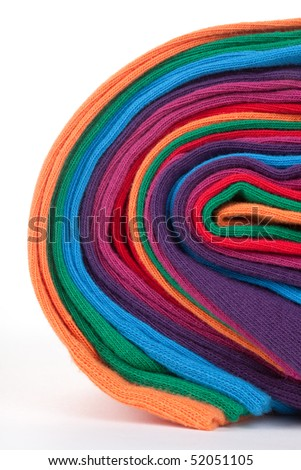 Clew of colorful cotton textile fabric socks isolated on white