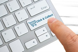 Click and collect concept - Keyboard buttons with shopping cart icon