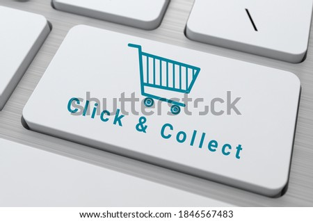 Photo of  Click and collect concept - Keyboard buttons with shopping cart icon