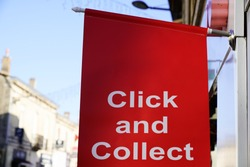 Click and Collect flag sign on shop street order shopping online and collect from a local store for free