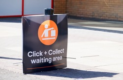 Click collect online internet shopping sign at shop car park lane