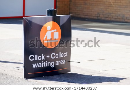 Photo of  Click collect online internet shopping sign at shop car park lane
