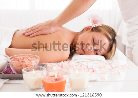 Client relaxing in massage at the spa
