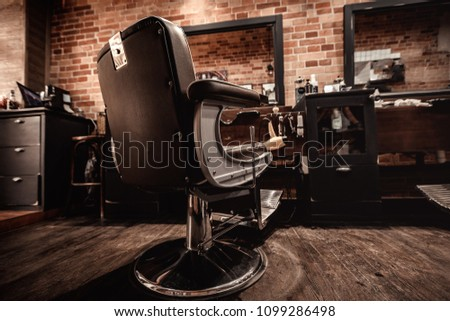 Client's stylish barber chair. barber shop for men