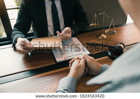 Clients come to seek advice for the law regarding privacy violations with the lawyer at the office. Stockfoto ©
