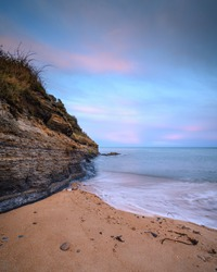 Cliff and Beach at Iron Scars, on the shoreline  at Howick on the Northumberland coast, AONB, where there are several sandy coves