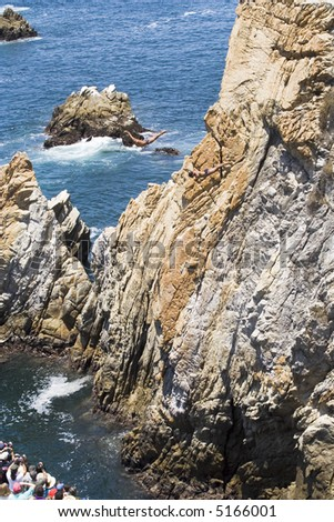 Cliff diving in Acapulco, Mexico with two cliff divers in the air