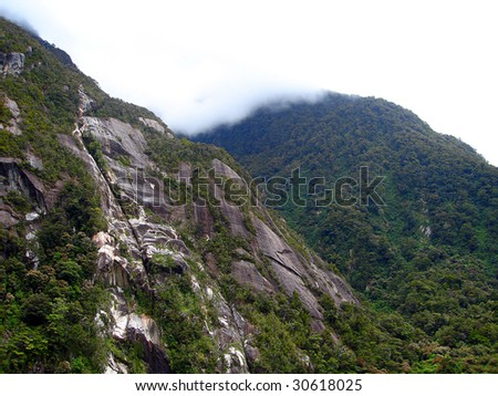 Cliff faces of the mountains containing Milford Sound, New Zealand
