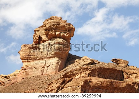 Cliff on a sky clouds background.Timna Park. Israel
