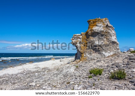 """Cliff on the Baltic Sea coastline. F�¥r�¶ island in Gotland, Sweden. This rock formation is called """"rauk"""" in Swedish."""