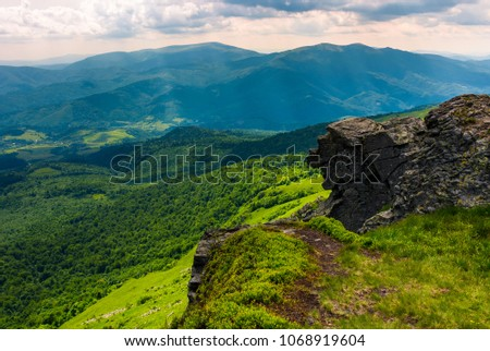 cliff over the hill in high mountains. beautiful summer landscape and travel concept #1068919604