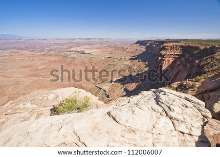Cliff Side View over Canyonland's Sandstone Terrain