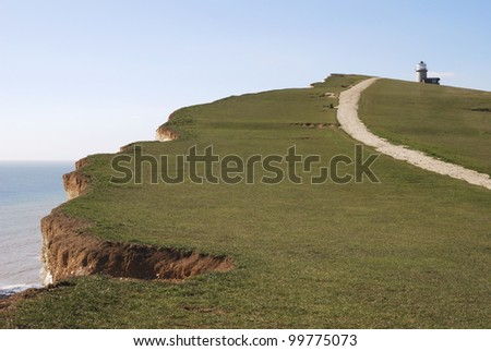 Cliff top at Beachy Head with path and Belle Tout lighthouse. Eastbourne. East Sussex. England