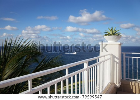 Cliff-top terrace looking out over a tropical ocean