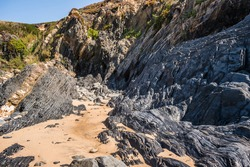 Cliff with spectacular shale rock formations next to Almograve beach, Vicentine Coast Natural Park PORTUGAL