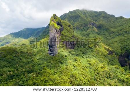 Cliff with the shape of a Giant Tiki head on Raiatea island. Raiatea, Leeward Islands, Society Islands, French Polynesia, Oceania, South Pacific Ocean.