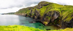Cliffs of Carrick-a-rede rope bridge in Ballintoy, Co. Antrim. Landscape of Northern Ireland.Traveling through the Causeway Coastal Route.