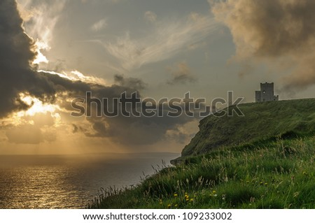 Cliffs of Moher Sunset, O Briens Tower, County Clare, Ireland.