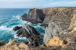 Cliffs with steep rocks in turquoise seascape, Vicentine Coast Natural Park - Cabo Sardão PORTUGAL