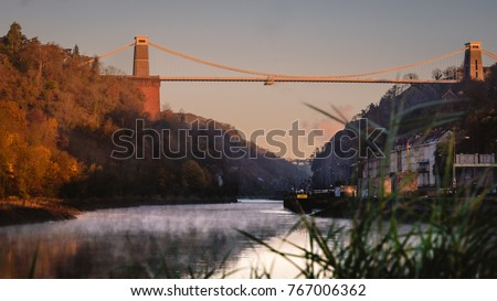 Clifton Suspension bridge at sunrise, with grass in the foreground, in Bristol, UK #767006362