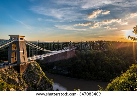 Clifton Suspension Bridge, Bristol, UK with sunset and sunbeams #347083409