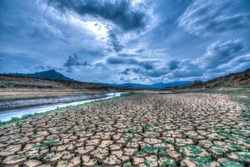 Climate change and drought land, Global warming concept, drought cracked river banks landscape, dry reservoir