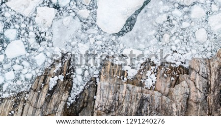 Climate Change and Global Warming - Icebergs drone aerial image top view. Icebergs from melting glacier in icefjord in Ilulissat, Greenland. Arctic nature ice landscape in Unesco World Heritage Site.