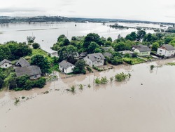 Climate change and the effects of global warming. Flooded houses, streets, farms and fields after heavy rains. Environmental natural disaster. Concept of global catastrophes in the world