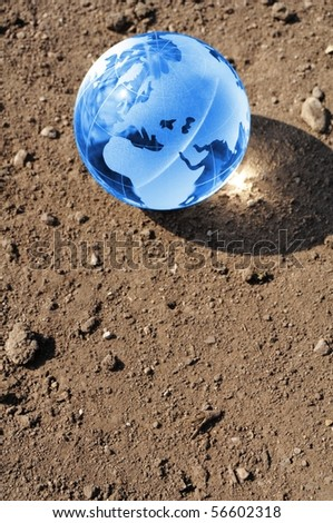 climate change concept with earth planet on dry soil and copyspace - stock photo