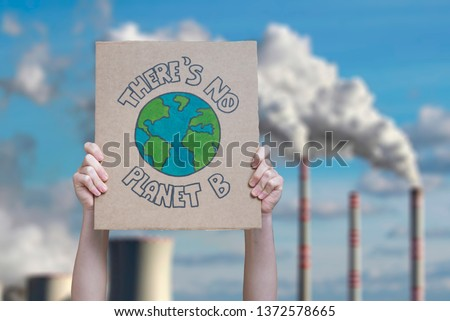 Climate change manifestation poster on an industrial fossil fuel burning  #1372578665