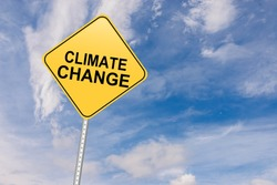 Climate Change Road Sign against sky