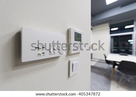 Climate control on office wall, selective focus