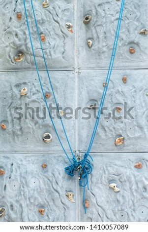 Climb the wall and climb the rope to climb the rock.  The rope is a dangerous protective device. #1410057089