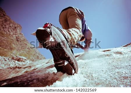 Climber climbs on ice. #142022569