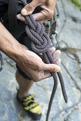 climber doing a figure eight knot re-threaded